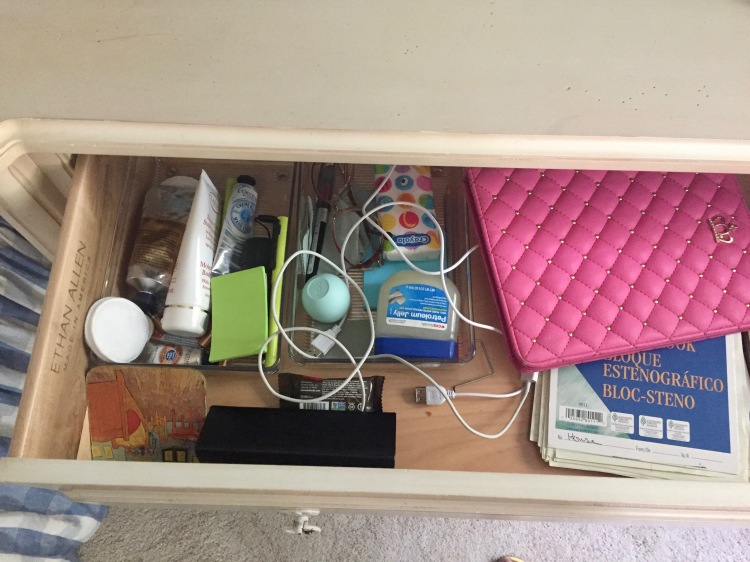pic of messy bedside table drawer